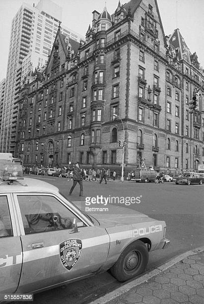 Police direct traffic outside the Dakota an apartment house December 9th the morning after former Beatle John Lennon was shot to death in front of...