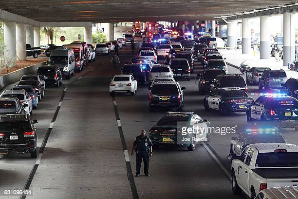 Police direct traffic outside the Fort LauderdaleHollywood International airport after a shooting took place near the baggage claim on January 6 2017...