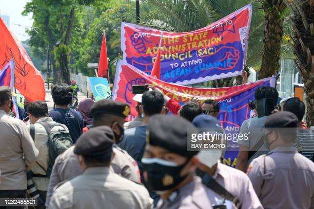 Police disperse demonstrators calling for democracy in Myanmar during a rally outside the Association of Southeast Asian Nations building in Jakarta...