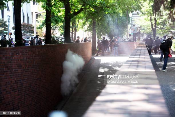 Police disperse the crowd with incendiary devices as altright activists antifascist protestors and people on all sides of the political spectrum...