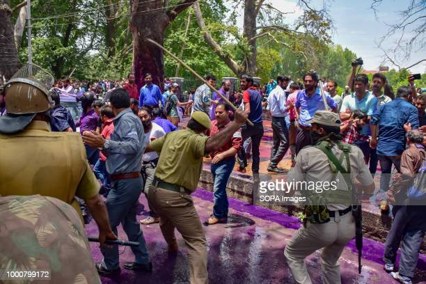Police disperse the Government teachers during anti government protest in Srinagar on tuesday Police used water cannons batons and detained dozens of...