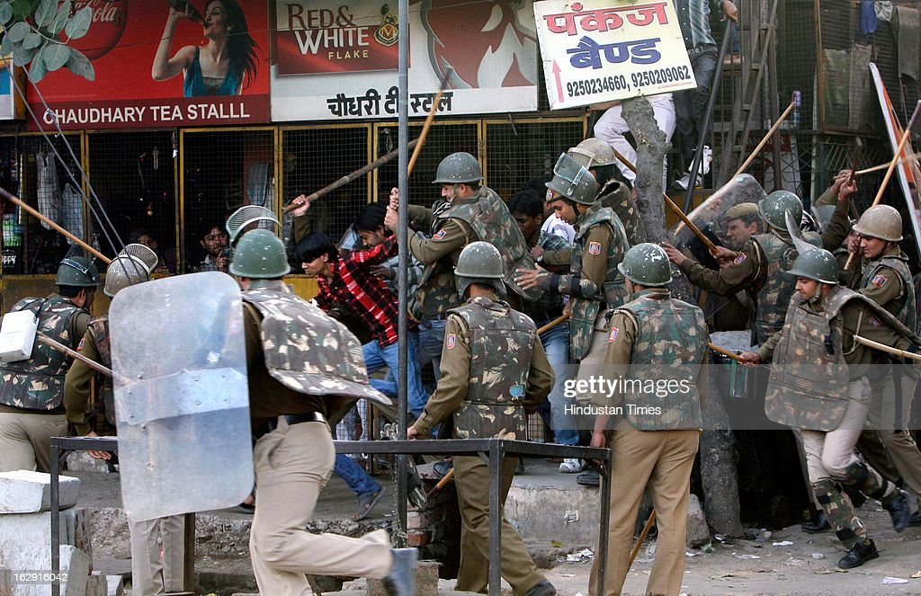 Police dispersing crowd at Sanjay Gandhi hospital as people ransacked the hospital during a protest after an eight-year-old girl, student of Class 2, was allegedly raped inside the premises of a North Delhi Municipal Corporation school at Mangolpuri Area on March 1, 2013 in New Delhi, India.