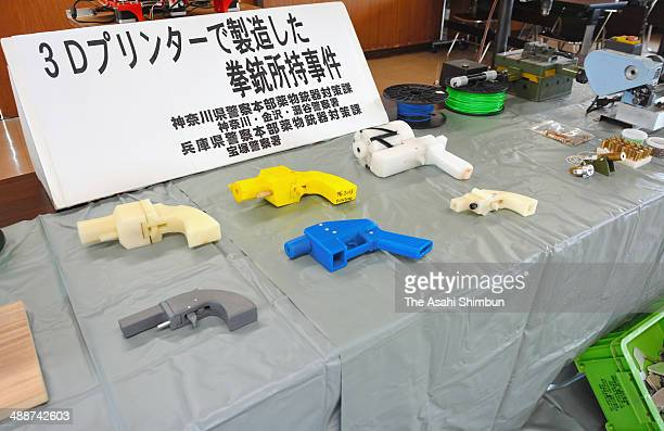 Police display the seized plastic guns created by 3D printer at Kanagawa Police Station on May 8 2014 in Yokohama Kanagawa Japan A man was arrested...