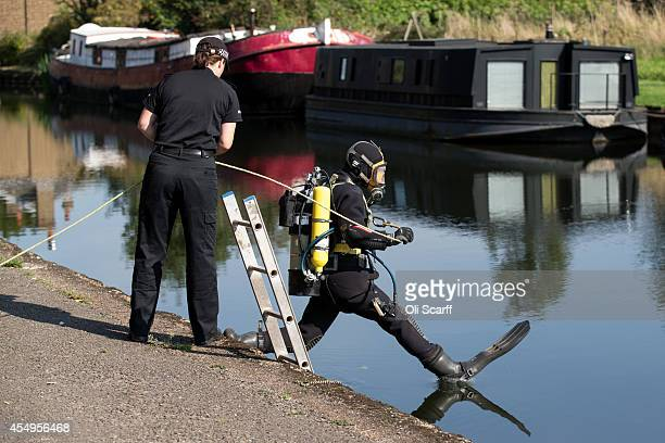 A police diver enters the Grand Union Canal to search for missing schoolgirl Alice Gross on September 8 2014 in London England Fourteenyearold Alice...