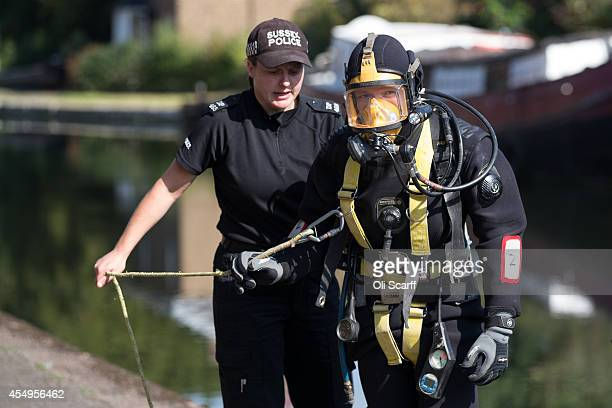 Police diver prepares to enter the Grand Union Canal to search for missing schoolgirl Alice Gross on September 8, 2014 in London, England....
