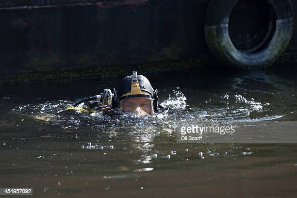 Police diver searches a stretch of the Grand Union Canal looking for missing schoolgirl Alice Gross on September 8, 2014 in London, England....