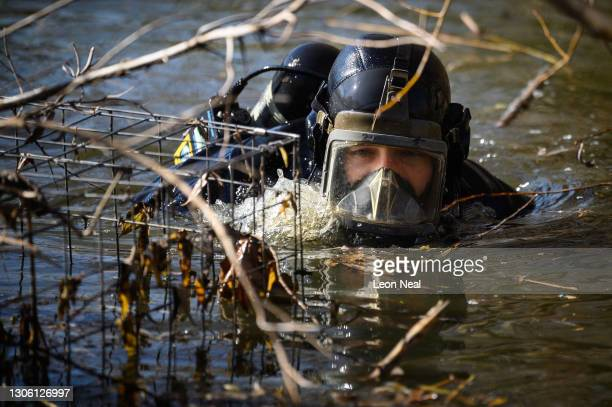 Police diver searches Mount Pond on Clapham Common as the hunt for missing woman Sarah Everard enters its fifth day, on March 09, 2021 in London,...