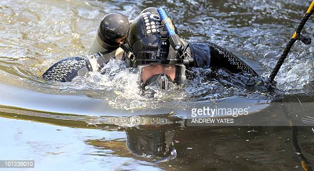 A police diver searches the River Aire in Shipley West Yorkshire in northern England on May 28 2010 A British man accused of murdering three...
