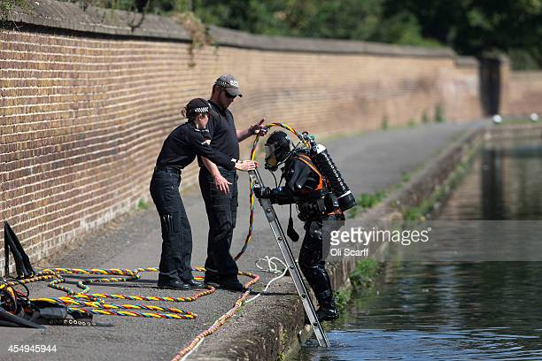 Police divers search a stretch of the Grand Union Canal looking for missing schoolgirl Alice Gross on September 8 2014 in London England...