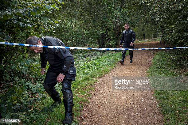 Police divers walk along the bank of the River Brent where police are searching for missing schoolgirl Alice Gross on September 23 2014 in London...