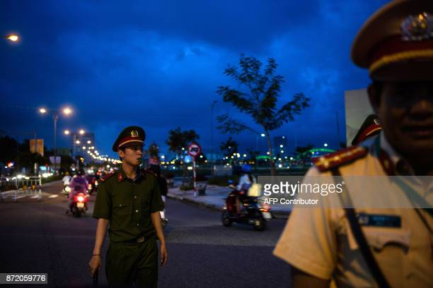 Police divert traffic for delegates being transported around the central Vietnamese city of Danang on November 9 2017 as the city gears up for the...