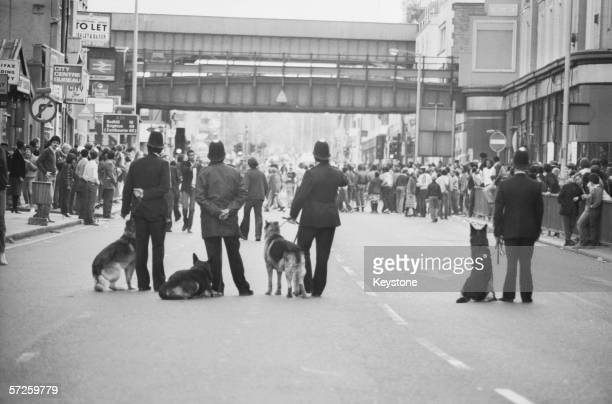 Police dog handlers on Atlantic Road on the second day of riots in Brixton South London 13th April 1981