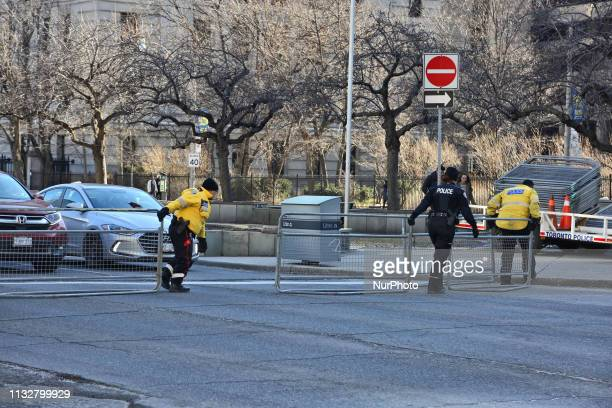 Police drag metal barricades to separate groups of protestors during a ProMuslim and AntiMuslim rally held in Toronto Ontario Canada on March 23 2019...