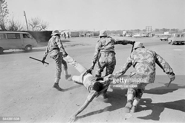Police Dragging Protestor at AntiApartheid Demonstrations in Soweto