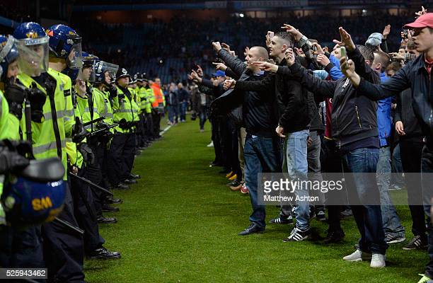 Police draw batons and form a line to stop Aston Villa fans as they try to get to the West Bromwich Albion Fans in the final few minutes of the match...