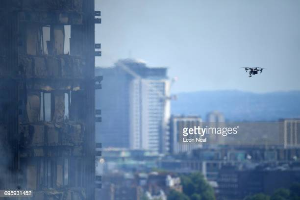 A police drone flys around the 24 storey residential Grenfell Tower block in Latimer Road West London on June 14 2017 in London England The Mayor of...