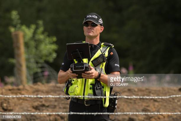 Police drone pilot flies his vehicle above Toddbrook Reservoir as engineers and members of the emergency services work to pump water from the...