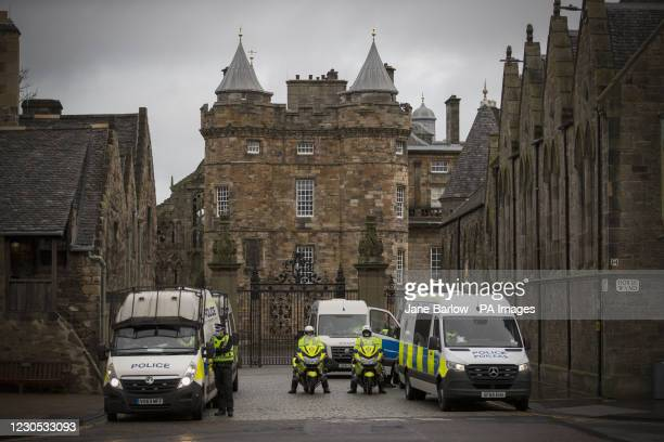 Police during a Scotland Against Lockdown protest outside the Place of Holyrood house opposite the Scottish Parliament in Edinburgh. Under current...