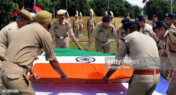 Police during a wreath laying ceremony of JK Police Head Constable Krishan Chand who was killed in terrorist attack at Pantha Chowk at District...