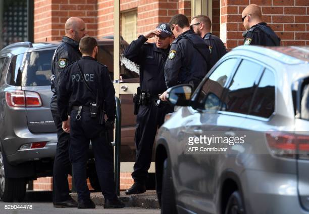 Police emerge from a block of flats in the Sydney suburb of Lakemba on August 1 after counterterrorism raids across the city at the weekend Four men...