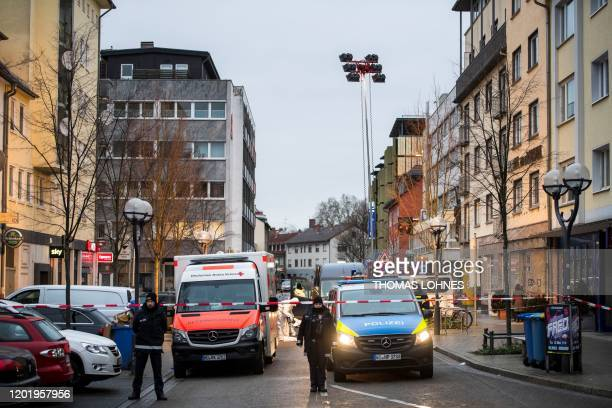 Police emergency services and forensic police are seen behind a police cordon near a shisha bar at the Heumarkt in the centre of Hanau near Frankfurt...
