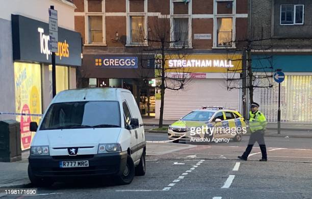 Police emergency services are seen at the site of an incident after a man has been shot dead by police in South London following stabbing several...