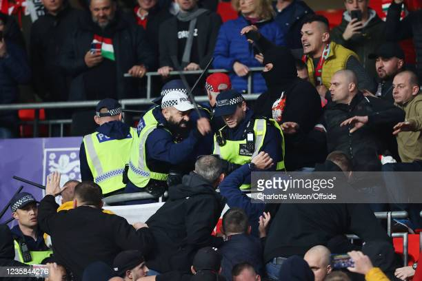 Police engage with fans as fights break out in the stands during the 2022 FIFA World Cup Qualifier match between England and Hungary at Wembley...