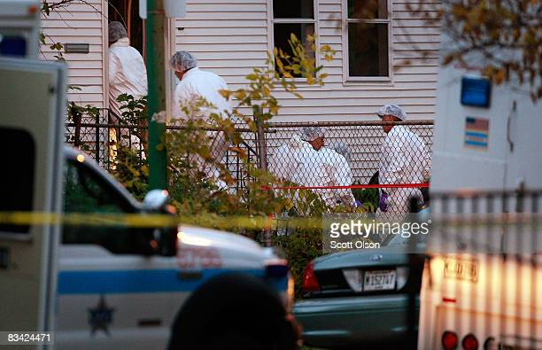 Police enter a home in the Englewood neighborhood where 57yearold Darnell Hudson Donerson the mother of Oscar winner Jennifer Hudson was reported to...