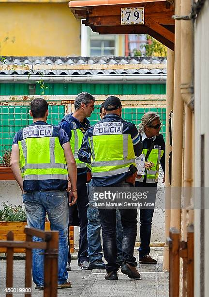 Police enter the house of an alleged pedophile believed to have kidnapped and abused five children in Madrid on September 24 2014 in Santander Spain...