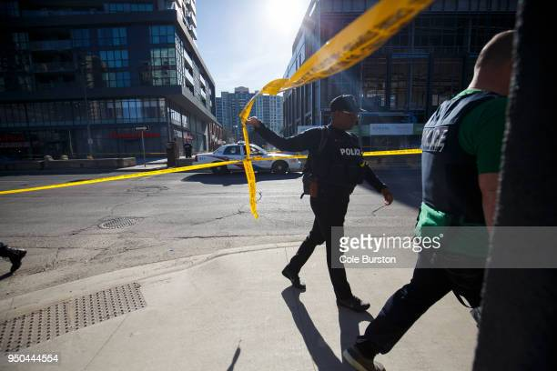 Police enter the scene on Yonge St at near Finch Ave after a van plowed into pedestrians on April 23 2018 in Toronto Canada A suspect identified as...