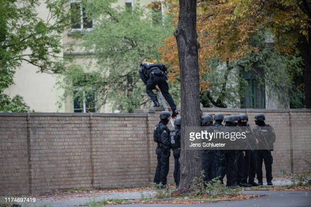 Police entry a Jewish cemetery over a wall near the scene of a shooting that has left two people dead on October 9 2019 in Halle Germany Law...