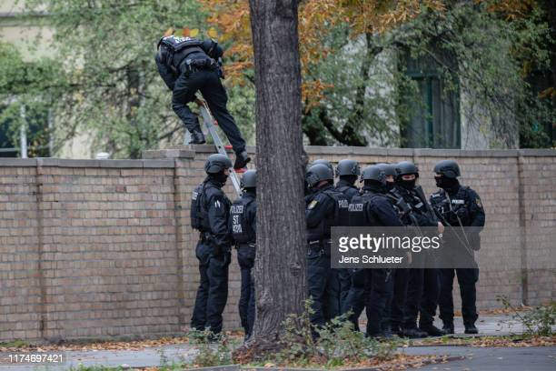 Police entry a Jewish cemetery over a wall near the scene of a shooting that has left two people dead on October 9, 2019 in Halle, Germany. Law...