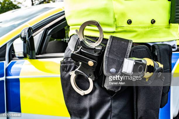 police equipment belt - police taser stock pictures, royalty-free photos & images