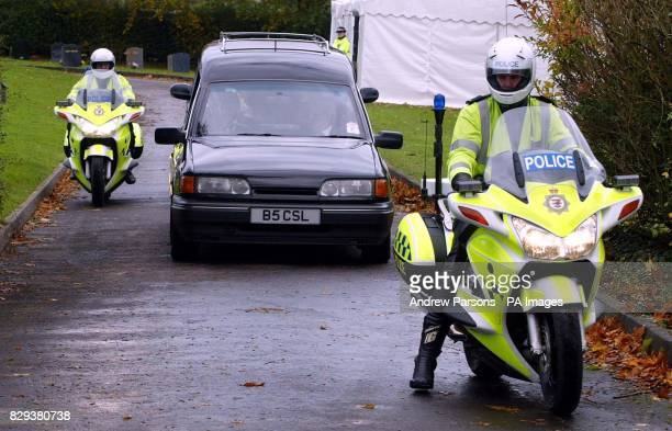 A police escord guides the coffin of Stephen Smith as it is taken away from Mayshill Cemetery in Nibley near Yate in South Gloucestershire on its way...