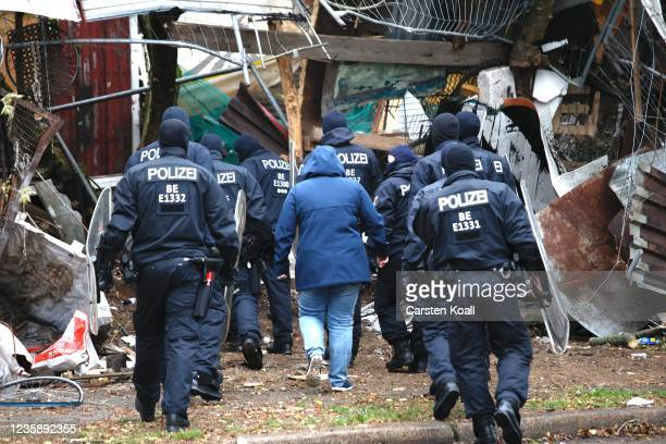 Police escort a bailiff in the location of the left alternative site trailer Camp Kopi on October 15, 2021 in Berlin, Germany. The so-called...