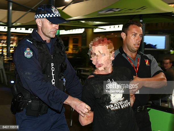 Police escort a party goer after a fight on the beach as Schoolies 2006 kicks off 17 November 2006 SHD Picture by PAUL HARRIS