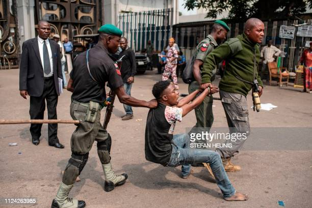 Police escort a suspected thief from the Tafawa Balewa Square in Lagos where the official opposition the Peoples Democratic Party will hold a rally...