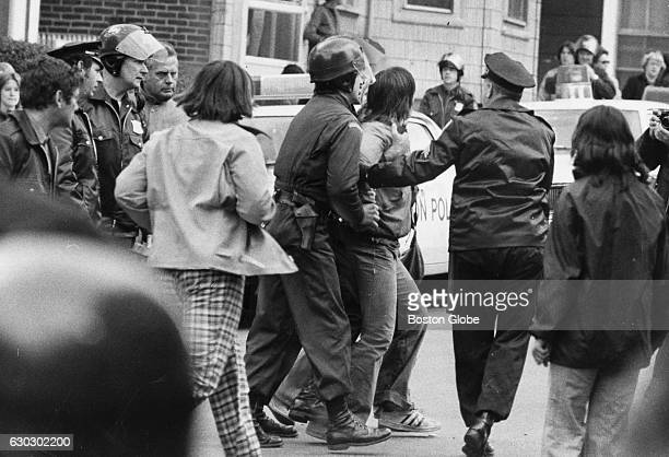 Police escort a young man who was arrested on G Street in front of South Boston High School on Oct 8 1974 An initiative to desegregate Boston Public...