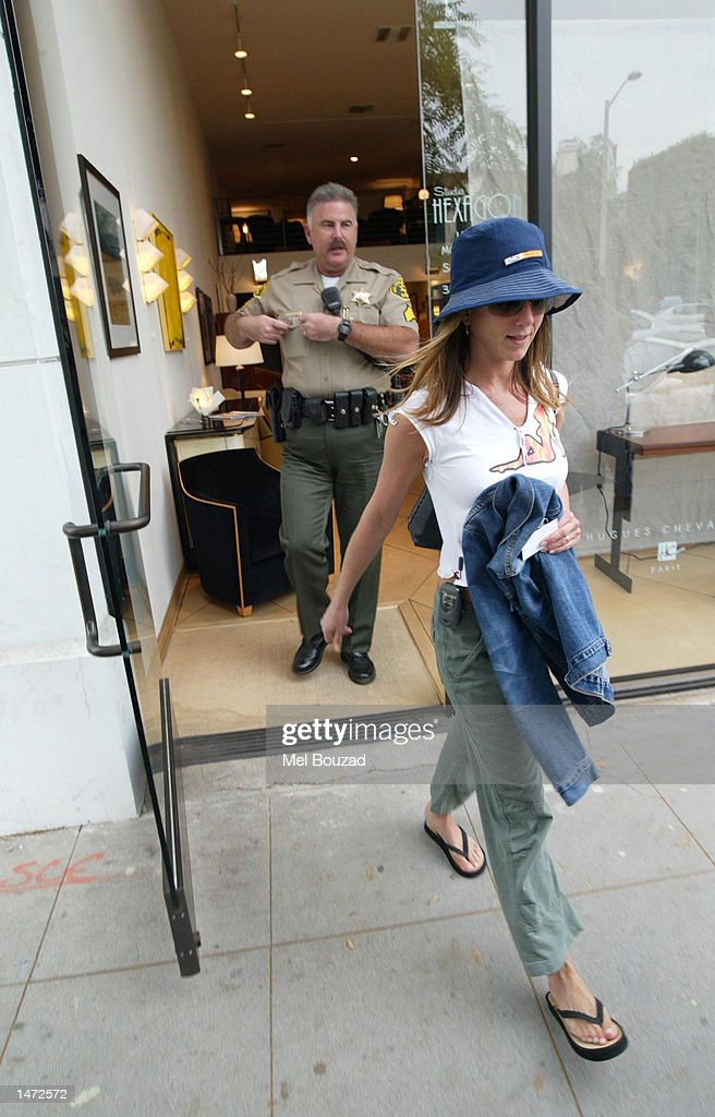 Police Escort Actress Jennifer Aniston Out Of A Furniture Store October 12,  2002 In Beverly