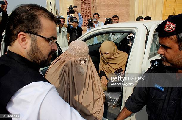 Police escort Afghan refugee woman Sharbat Gula before a court hearing in Peshawar Pakistan on November 04 2016 The Afghan woman whose teenage...