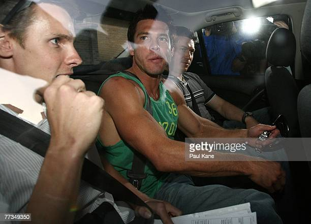 Police escort AFL player Ben Cousins from Curtin House on October 16 2007 in Perth Australia Cousins has been charged with drug possession and...