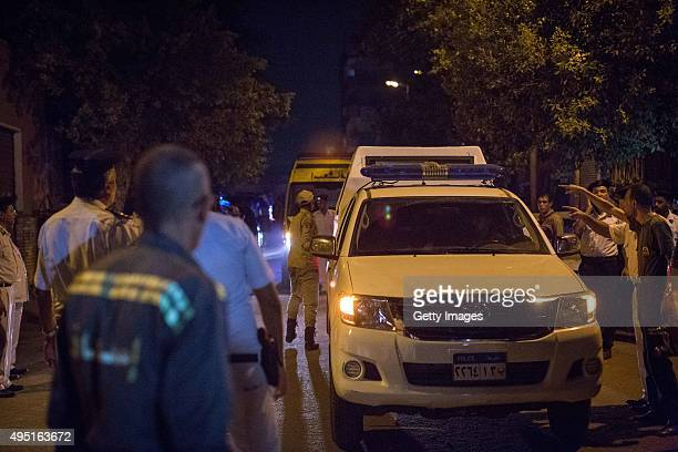 Police escort ambulances containing corpses of victims retrieved from a Russian plane crash is stored inside an ambulance on October 31 2015 in Cairo...