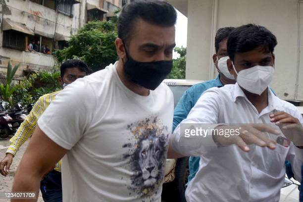 Police escort arrested Bollywood star Shilpa Shetty's husband Raj Kundra for allegedly producing and broadcasting pornographic films online, in...