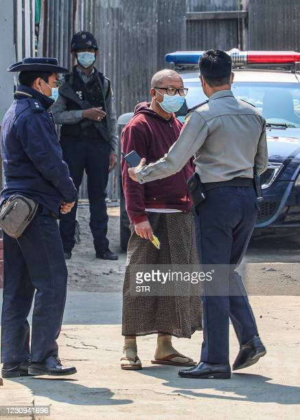 Police escort Buddhist abbot Myawaddy Mingyi Sayadaw at a court compound in Mandalay on February 3, 2021 following his arrest as a long-time critic...