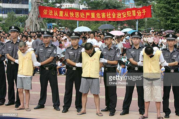 Police escort convicted criminals who had committed robbery during a public sentence at a plaza on September 15 2005 in Guangzhou of Guangdong...