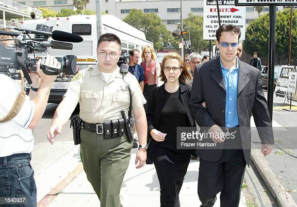 Police escort Delinah and Noah Blake the son and daughter of actor Robert Blake as they exit the Van Nuys courthouse after a Superior Court...
