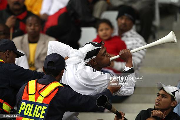 Police escort fans out of the stadium during the Absa Premiership match between Vasco Da Gama and Orlando Pirates, at Cape Town Stadium on August 27,...