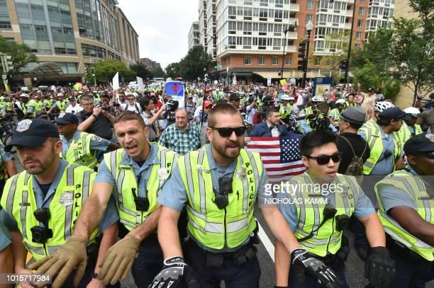 TOPSHOT Police escort farright demonstrators led by 'Unite the Right' organizer Jason Kessler during a rally at Lafayette Park opposite the White...