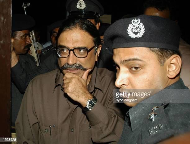 Police escort Former prime minister Benazir Bhutto's jailed husband Asif Ali Zardari at a local hospital November 8, 2002 in Karachi, Pakistan. The...