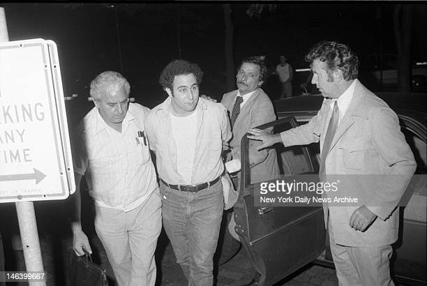 Police escort handcuffed Son of Sam suspect David Berkowitz into Police headquarters in lower Manhattan Alan Aaronson/NY Daily News via Getty Images